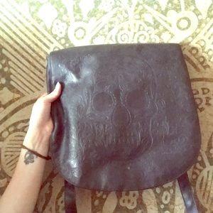 Black leather skull embossed bag